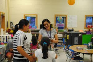 Mrs. Escudero welcoming a family.